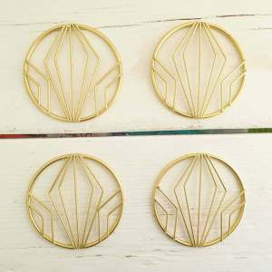 Gold Geometric Coasters by Gisela Graham