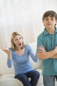 Mother Shouting While Son Ignoring Her At Home