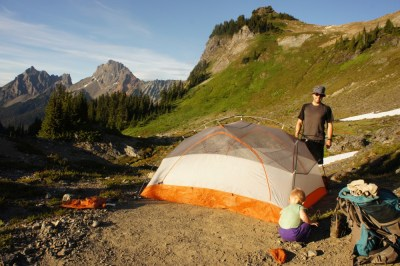 Setting up the tent, border peaks in the background