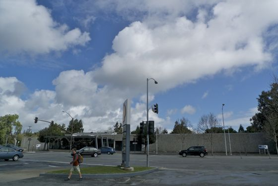 Puffy white clouds over El Camino Real in Menlo Park, CA