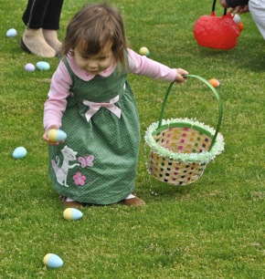 toddler enjoying egg hunt in Menlo Park