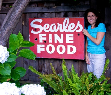 Irene Searles with Searles Find Food sign