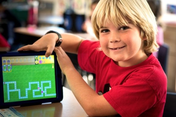 Boy showing coding progress