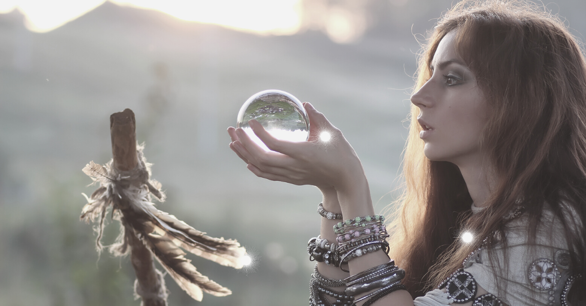 A woman gazing into a crystal ball