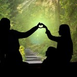 two people forming a heart with their fingers