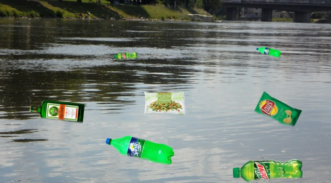 Locals Dump Only Green Trash Into Genesee River in Honor of Saint Patrick's Day