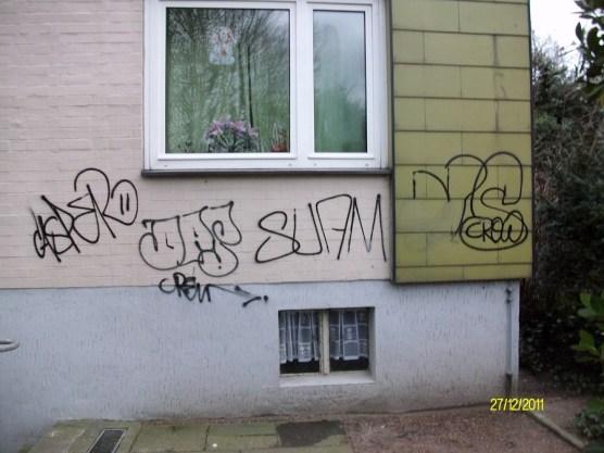 Graffitientfernung gestrichene Wand