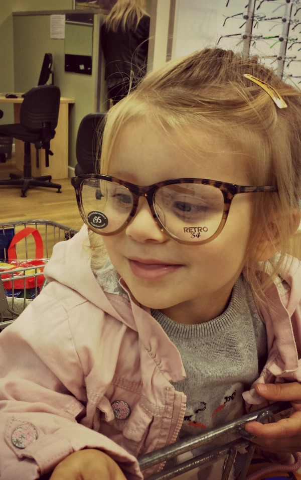 child in large glasses