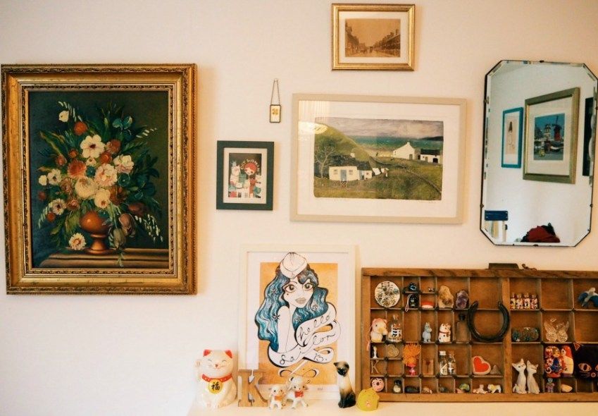 A corner of Katy from modern Mummy's home, showing off a homely gallery wall featuring a printers tray full of memories.