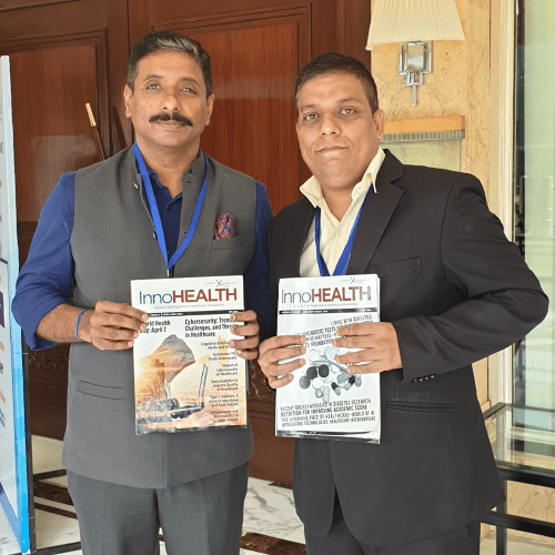 Dr.-Anil-Pillai-and-Sanjay-Gaur-holding-the-InnoHEALTH-Magazine-at-Patient-Experience-Conclave-and-Awards-2019