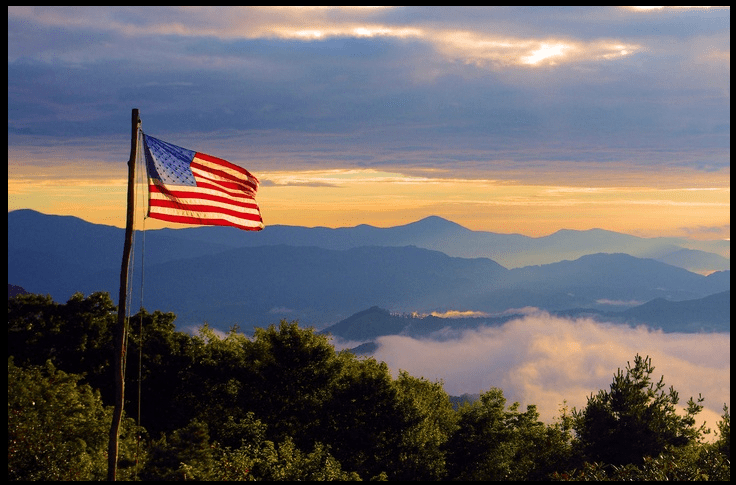 American Flag Flying over Appalachian Mountains