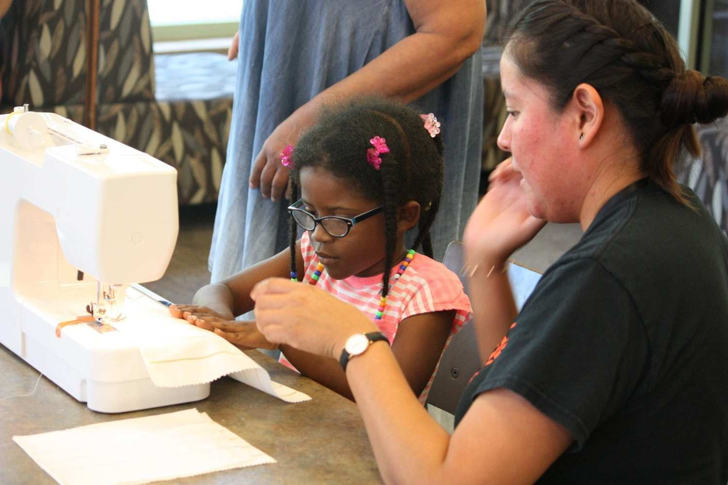Child sewing - Hillsborough County Public Library