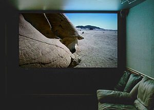 Home theater projection screen displaying a hi...