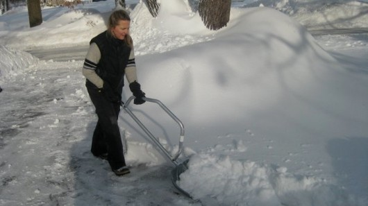 The SnowBow's bow-shaped handle reportedly allows users to shovel snow with little or no bending