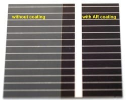 Picture 1: A comparison of the reflection from a cover glass on a crystalline Silicon cell with and without the multilayer AR coating.