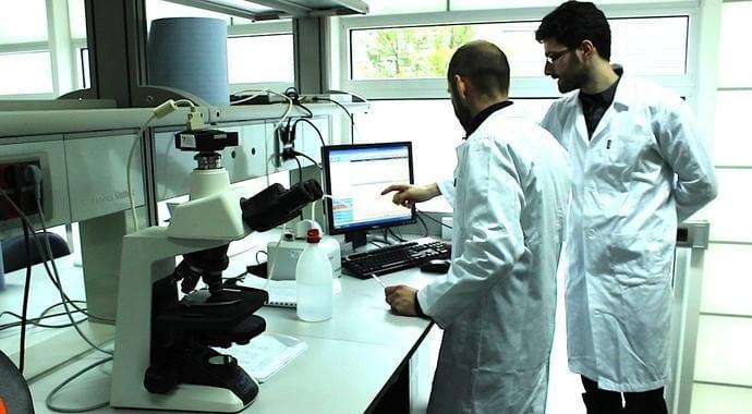 David Horna (right) in Aglaris Cell's lab. Credit: PCM