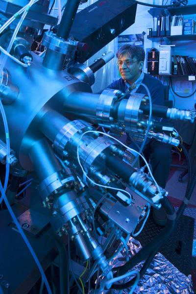 This photo shows Nitin Samarth in his research lab at Penn State working with the molecular beam epitaxy equipment, which provides an ultra-pure environment for his research team's experiments. Credit: Penn State University