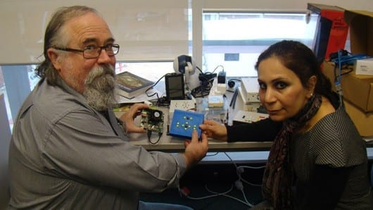Dr Iain Murray and PhD student Azadeh Nazemi with the digital reading system they developed at Curtin University
