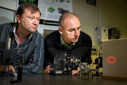 Dr Vladlen Shvedov (L) and Dr Cyril Hnatovsky adjusting the hollow laser beam in their lab at RSPE. Image Stuart Hay, ANU