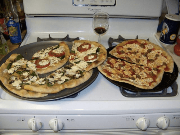 """Two pizzas sitting on top of a stove top oven,"" is how a Google program described this image. via PCWorld.com"