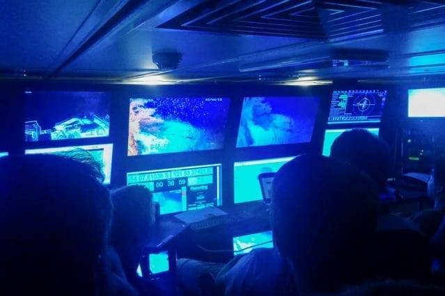 Researchers watch underwater footage taken by various AUVs exploring Australia's Scott Reef. Courtesy of the researchers
