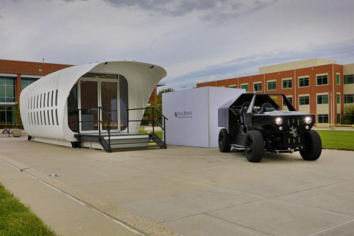 Oak Ridge National Laboratory's Additive Manufacturing Integrated Energy (AMIE) demonstration connects a 3D-printed building and vehicle to showcase a new approach to energy use, storage and consumption. Photo by Carlos Jones
