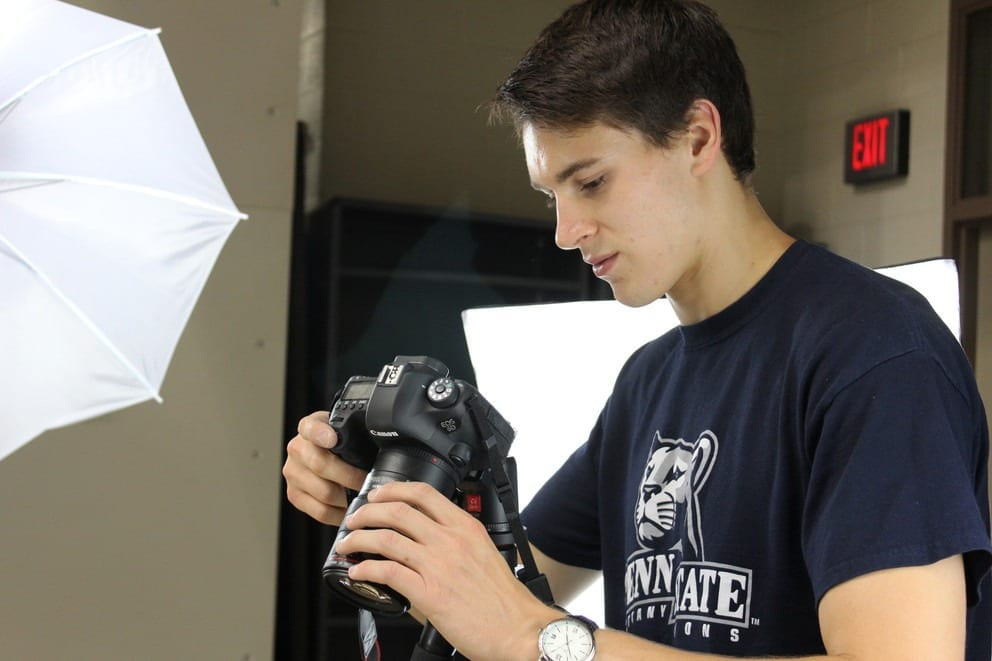 Andrew Bellows, a graduate student in mechanical engineering, takes photos of a bottle opener from different angles in order to generate a point cloud from which the object can be 3D-printed. Image: Pamela Krewson Wertz