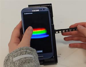 Smartphone linked to a handheld spectral analyzer for diagnostics
