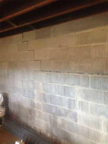 bowing cinder block wall with crack