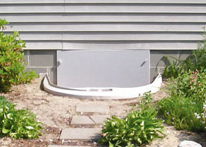 Rigid plastic crawl space access well installed in a Fargo crawl space