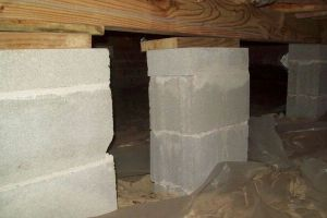 a poorly designed crawl space support system installed in a Maple Grove home