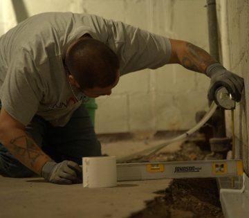 IBA Crew installing Basement Waterproofing