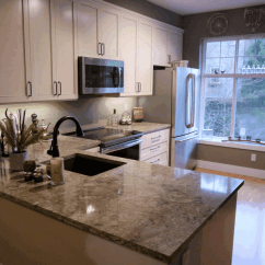 Kitchen Reface Cabinet Cost Redmond Traditional Maple Cabinets In Swiss Coffee With An Umber Glaze The Style Campbell Cambria Quartz Countertops Nevern