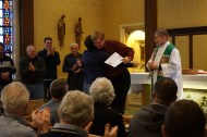 At the final Mass awards are given out. One man received a certificate for his 65th retreat.