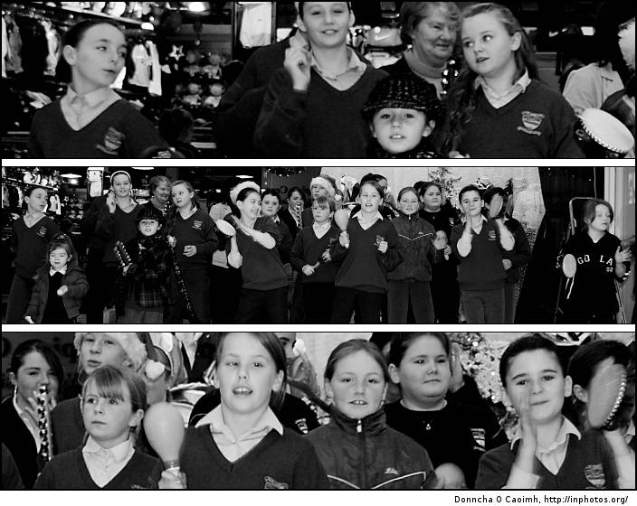 School girls sing the carols