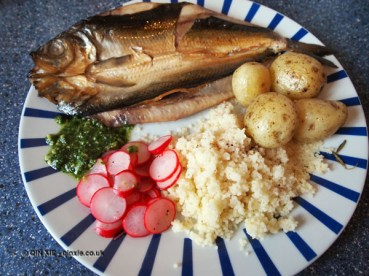 Kipper with lovage pesto, radish salad, cous cous and potatoes