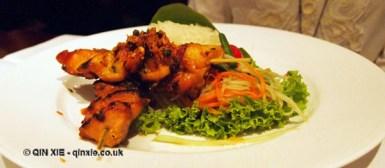 Char-grilled chicken en brochette and sweet rice rolls at Patara, Greek Street