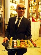 Waiter with canapés, Laurent Perrier Tous Les Sense at Massimo, The Corinthia, London