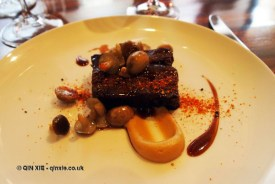 Braised beef featherblade, smoked onion puree, shimiji mushrooms and togarashi spice, Maze