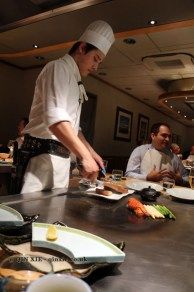 Chef cooking on the teppan, The Matsuri, St James
