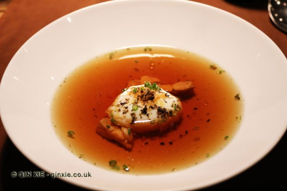Slow cooked egg in veal consommé, Table No 1 by Jason Atherton, Shanghai