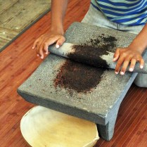 Grinding cocoa nibs, Grenada Chocolate Festival