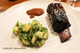Innis and Gunn glazed sugar pit ribs of Glenarm Estate beef with Pink Fir apple, potatoes, green onions and Guinness mustard, Marks Kitchen Library at The Tramshed
