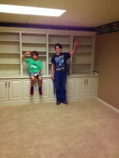 """Middle Boy and Oldest saying """"goodbye """" to the old school room. They look so big in the room now..."""