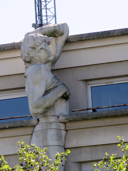 17a. Marble caryatid on the police station