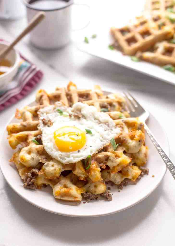 Savory Waffles with Sausage and Cheddar with an egg on top