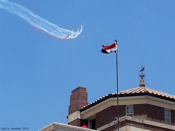 Egypt's Silver Stars Skywriting Egypt Flag Red, White, Black: Egypt's Military jet contrails over downtown, Tahrir Square, Cairo, Egypt 2013. Taken from the Gizeera Club on Friday morning.