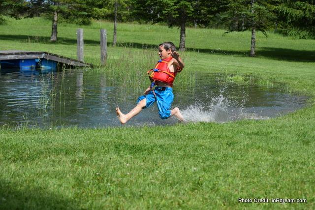 Splashing in the pond. Kawartha Lakes Pond, Country living in Kawartha Lakes