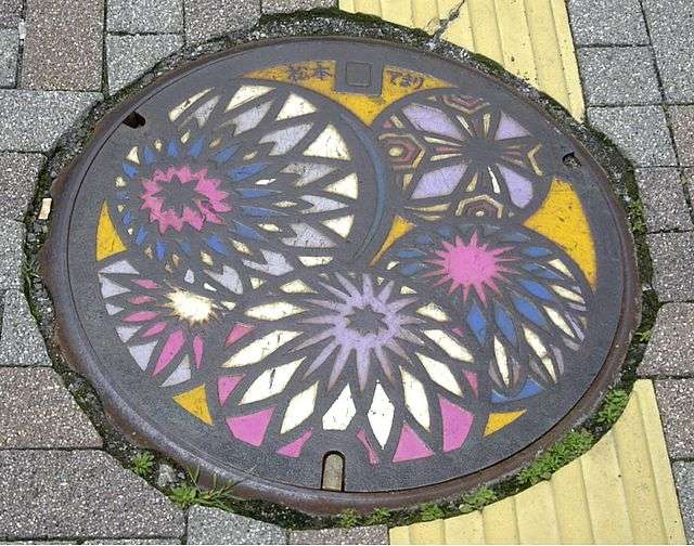 """""""MatsumotoManholeCover"""" by Original uploader was Rei at en.wikipedia - Originally from en.wikipedia; description page is/was here.. Licensed under CC BY-SA 3.0 via Wikimedia Commons - http://commons.wikimedia.org/wiki/File:MatsumotoManholeCover.jpg#mediaviewer/File:MatsumotoManholeCover.jpg"""