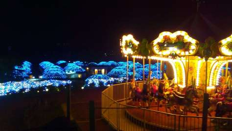 The merry-go-round and blueberry lodges lit up at night in Tokinosumika is stunning